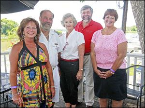 Chairs of the event from left: Diane and John Lark, Judy Stone, Skip Gaynor, and Deb Kienzle, enjoy the Commodore's Reception during the annual Homecoming weekend at  Maumee River Yacht Club on August 2, 2013.