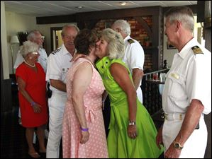 Commodore Ron Reeder and Lady Carla Smith , right, greet guests including Carol Crum, left.