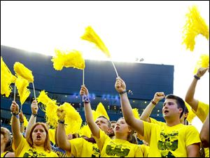Michigan fans celebrate the Wolverines' win.