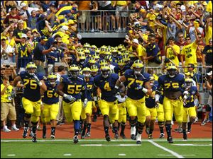 The University of Michigan football team takes the field.