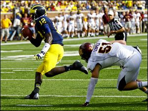 Devin Gardner (12) beats out Central Michigan's Cody Lopez (51) during a scramble.