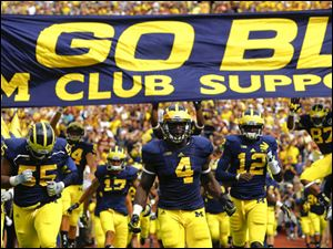 The University of Michigan football team takes the field to open its 2013 season.