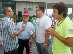 John Schlagheck, executive secretary of the Building Trades, left, Toledo city council members George Sarantou and Shaun Enright, and Enright's son, Shaun Enright, Jr, 13, right.