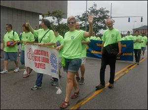 Members of the Association of Public Library Employees, Local 5242, an amalgamated local of the UAW, in the parade.