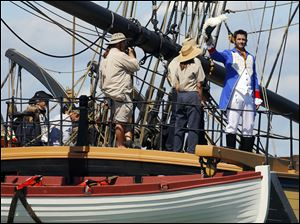 Actor Billy Campbell, portraying Comm. Oliver Hazard Perry, waves from the Brig Niagara during Monday's re-enactment, complete with 15 tall ships.