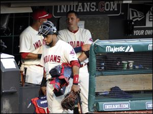 Cleveland Indians catcher Carlos Santana, front left, walks past Asdrubal Cabrera, back right, on his way to the clubhouse after a 7-2 loss.