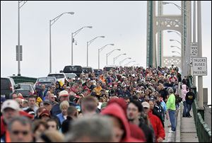 Thousands of walkers cross the 5-mile Mackinac Bridge during the annual Labor Day Bridge Walk in Mackinaw City, Mich. Labor Day is the only day pedestrians are allowed on the span, which connects Michigan's Upper and Lower peninsulas.