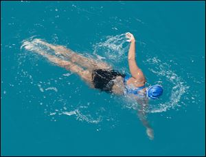 Diana Nyad, positioned about two miles off Key West, Fla., swims towards the completion of her approximately 110-mile trek from Cuba to the Florida Keys. Nyad, 64, is the first swimmer to cross the Florida Straits without the security of a shark cage.