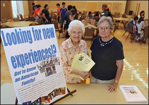 During an International Friendship Program meeting at Bowling Green State University, Phyllis Oster, left, and Dawn McCaghy sign up foreign BGSU students who want to be involved with American families as hosts.