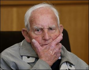 Siert Bruins , 92-year-old former member of the Nazi  Waffen SS, sits in the courtroom of the court in Hagen, Germany, Monday.`