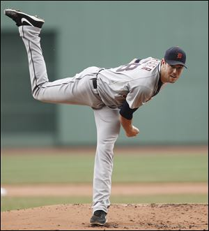 Detroit Tigers starting pitcher Doug Fister delivers against the Boston Red Sox during the first inning.