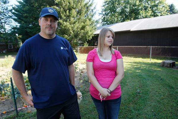 Rob-Scott-left-and-his-15-year-old-daughter-Ariel-ne