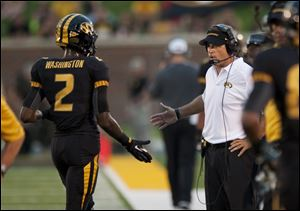 Missouri head coach Gary Pinkel, right, congratulates player L'Damian Washington, left, after Washington scored a touchdown during the third quarter of an NCAA college football game against Murray State, Saturday.