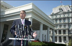 House Speaker John Boehner of Ohio speaks to reporters outside the White House following a meeting between President Obama and Congressional leaders to discuss the situation in Syria.