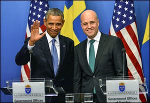 President Obama, left, with Swedish Prime Minister Fredrik Reinfeldt, smile during their news conference at the chancellery Rosenbad in Stockholm, Sweden today.