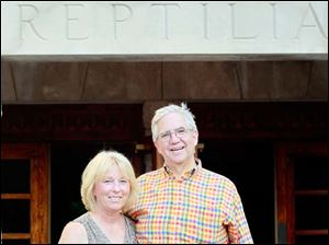 Dr. Mark Briel and Connie Briel in front of the reptile house.