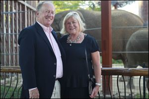 John and Ann Meier visit the elephant habitat during the Feast with the Beasts.