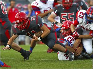 Bedford fullback Alec Hullibarger (11) is taken down by a group of St. Francis defenders.
