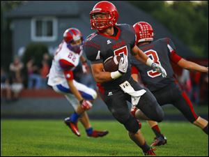 Bedford senior running back Connor Clements runs the ball after an interception on St. Francis.