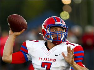 St. Francis senior quarterback David Nees goes for a pass.
