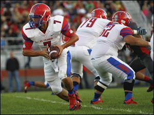 St. Francis senior quarterback David Nees goes for a hand off.
