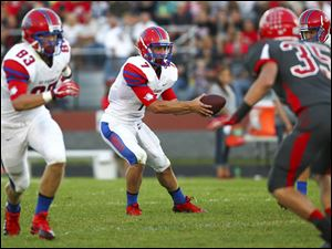St. Francis senior quarterback David Nees (7) goes for a hand off.