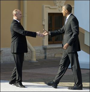 President Obama greets President Vladimir Putin during  the G-20 summit last week in St. Petersburg, Russia. The leaders are at odds over how to handle escalating violence in Syria.