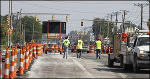 Orange barrels no long greet motorists along Secor Road now that the street's $5.4 million reconstruction is completed.