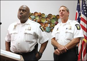 Toledo police Chief Derrick Diggs, left, and Capt. Brad Weis, discuss develop-ments in the case.