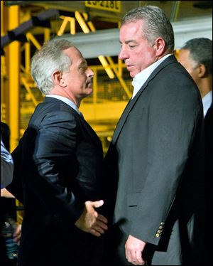 Sen. Bob Corker (R., Tenn.), left, shown with a UAW official in 2011, has urged Volkswagen to avoid dealing with the union at its Chattanooga factory.