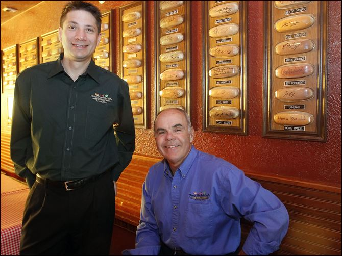 Tony Packo's Jimmy Harmon Jimmy Harmon, CEO of Tony Packo's, left, and Tony Packo, Jr., former owner and son of the company's founder, pose in front of hot dog buns signed by celebrities at the Front Street restaurant. Mr. Harmon has led Tony Packo's for 3½ months, taking over for Bob Bennett.