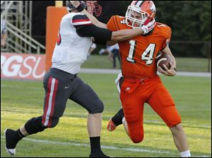 Sylvania Southview QB Griffin McDonald (10) is brought down by Central Catholic DB Ryan Roberts (13).