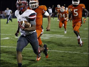 Central Catholic RB Tre'Von Wade (38) breaks away from the Sylvania Southview defense.