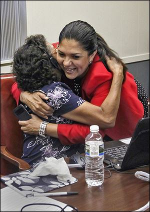 Volunteer Maggie Martinez gets a hug from county Auditor Anita Lopez at Teamsters hall. Ms. Lopez said her campaign is 'moving in the right direction.'