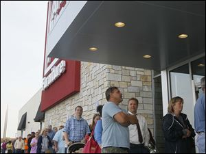 A line in front of the new store, as the grand opening included a free coffee maker for the first few hundred at the store.
