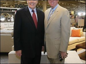 Gary Van Elslander, president of the company and son of the founder, left, and Kim Yost, CEO of Art Van Furniture.
