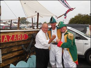 CiC Harbor Lights had a Don't Give Up the Ship theme in honor of the War of 1812 anniversary. L-R are Jim Stouffer, owner of Catawba Island Club, and Dave Strup and Tom Sydlowski, club members who are Toledoans. The two men dressed in costume along with their wives and others and helped created the ship float.