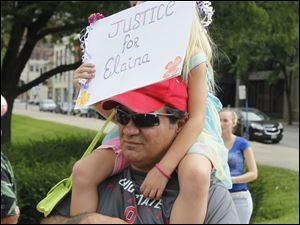 Donald Miller and his daughter Arianna Miller, 5,  of Toledo, attend the rally.