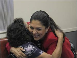 Phone bank volunteer Maggie Martinez is hugged by Toledo mayoral candidate Anita Lopez at Teamster's Hall.