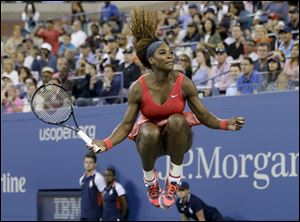 Serena Williams celebrates after beating Victoria Azarenka during the U.S. Open final Sunday in New York.