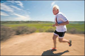 Jerry Brooks takes a jog in in Newport Beach, Calif. In the last 12 years Brooks has had both knees replaced and still competes in triathlons.