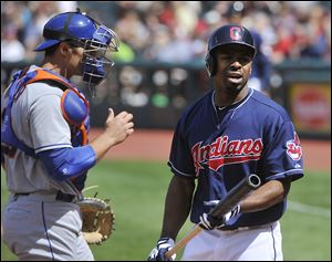 Cleveland's Michael Bourn has some words for home plate umpire Paul Emmel after being called out on strikes Sunday afternoon.