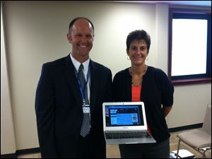 Cheryl O'Shea, director of technology for Sylvania schools and Adam Fineske, execu