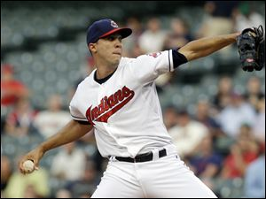 Cleveland Indians starting pitcher Ubaldo Jimenez delivers in the first inning.
