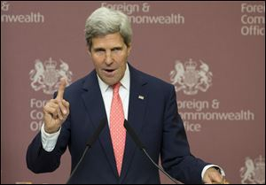 Secretary of State John Kerry gestures during a joint news conference with Britain Foreign Secretary William Hague at Foreign Office in London, today. Kerry renewed U.S. allegations that Syria's President Bashar Assad launched a chemical weapons attack against his own people.
