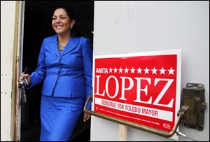 Anita Lopez leaves the Teamsters hall for some door-to-door campaigning. Her day included visits to a central-city church and a Latino club.