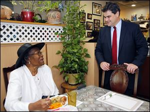 Democrat Joe McNamara talks with Dorothy Murchison at Ruby's Kitchen. Former Mayor Jack Ford, a council hopeful, joined him at the restaurant.