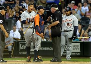 Detroit Tigers' Miguel Cabrera, center left, argues with umpire Brian Gorman with Tigers manager Jim Leyland, center, after he was ejected during the first inning.