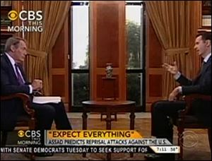 In this frame grab from video taken Sunday Syrian President Bashar Assad responds to a question from journalist Charlie Rose during an interview in Damascus, Syria.