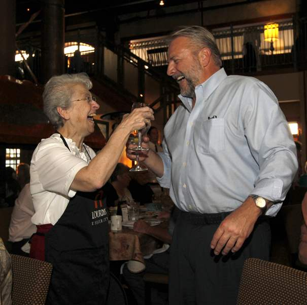 Sister-Ann-Carmen-Barone-toasts-with-Dick-LaValley-Jr-a-Lourdes-board-member
